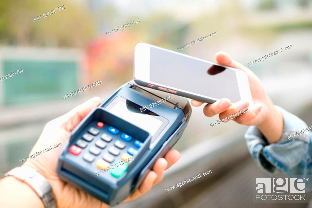 Stock Photo: Customer using mobile phone for pay by the bill.
