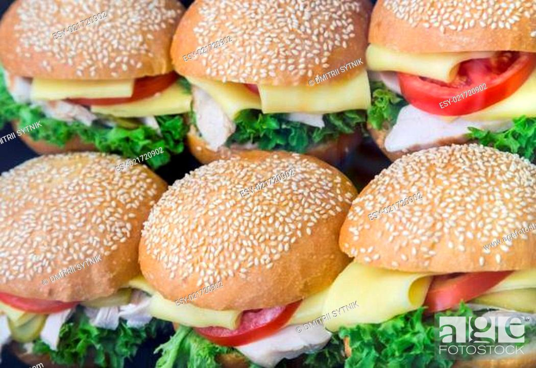 Stock Photo: some hamburgers with cheese in shop-window.