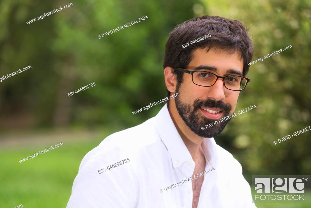 Stock Photo: Portrait of a handsome young man in the park.