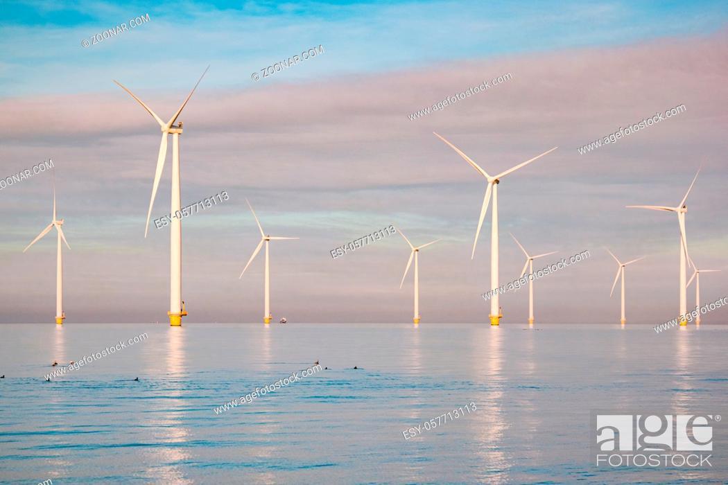 Photo de stock: Windmills for electric power production Netherlands Flevoland, Wind turbines farm in sea, windmill farm producing green energy. Netherlands.