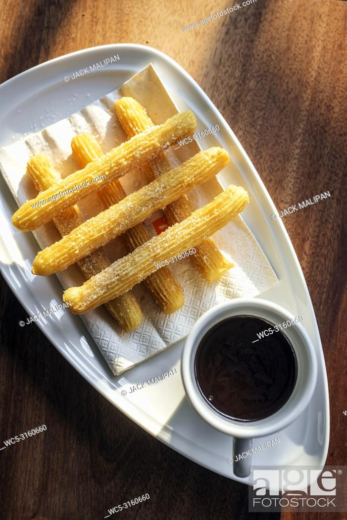 Stock Photo: churros and chocolate spanish donuts pastry doughnuts with sauce breakfast snack.