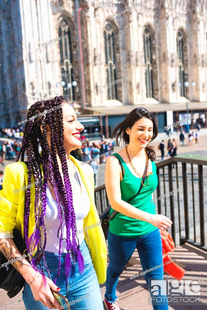 Stock Photo: Women outside Il Duomo, Milan, Italy.