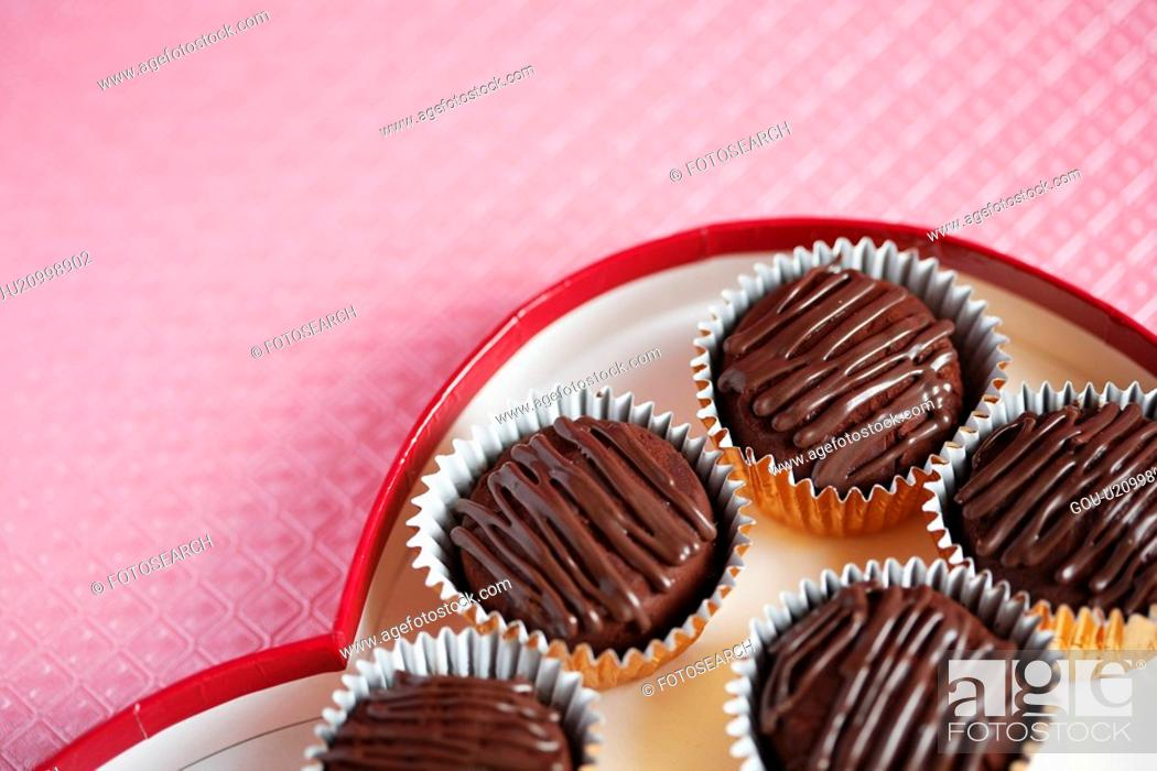 Stock Photo: Chocolates in box (close-up).