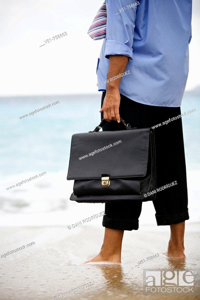 Stock Photo: Executive in the beach, out of place.