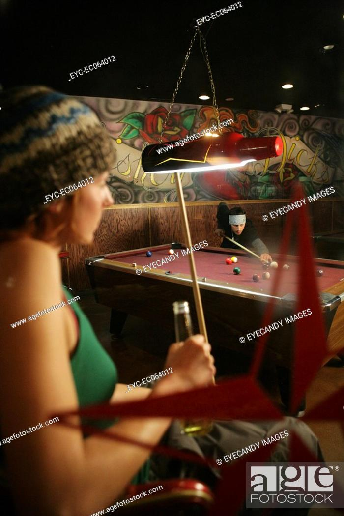 Stock Photo: Couple in a pool hall.