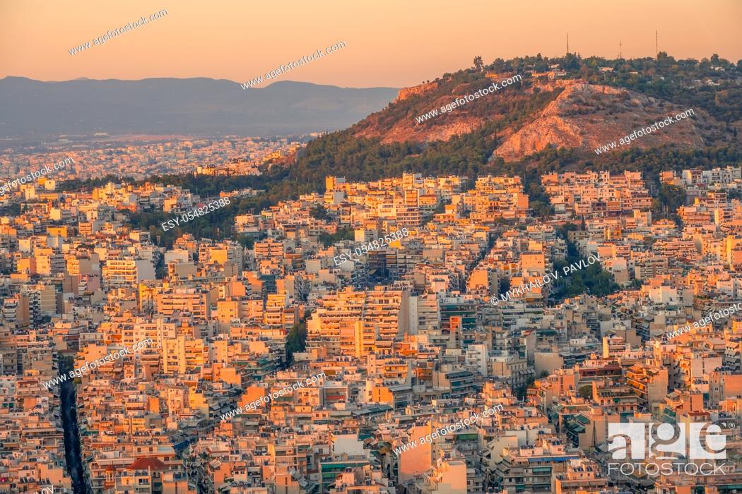 Stock Photo: Greece. Quiet summer evening. View of the rooftops of Athens at sunset.