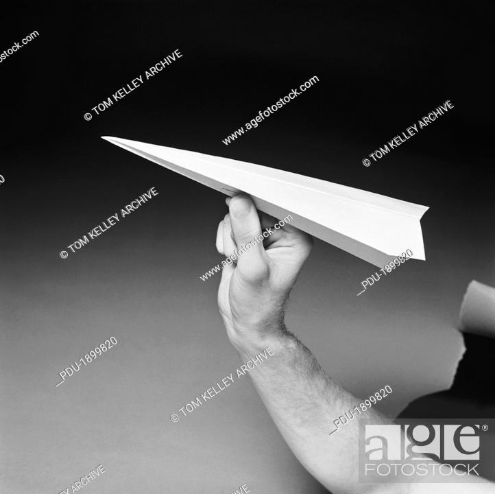 Stock Photo: Man holding paper airplane, close-up.