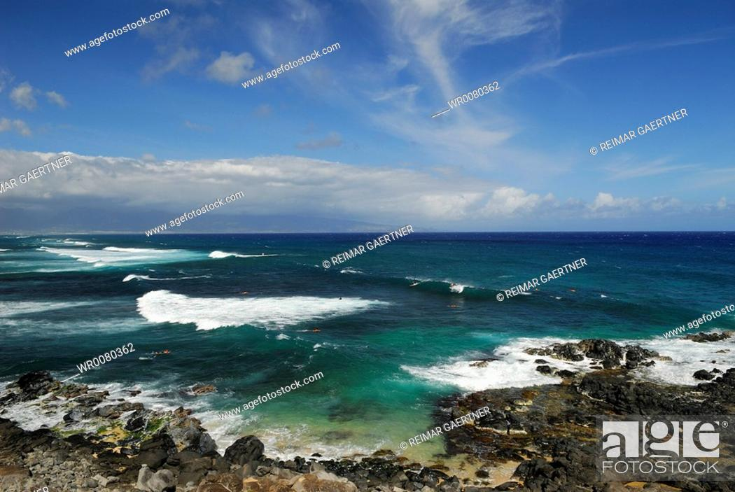 Stock Photo: Group of surfers with long waves at Hookipa Beach Maui.