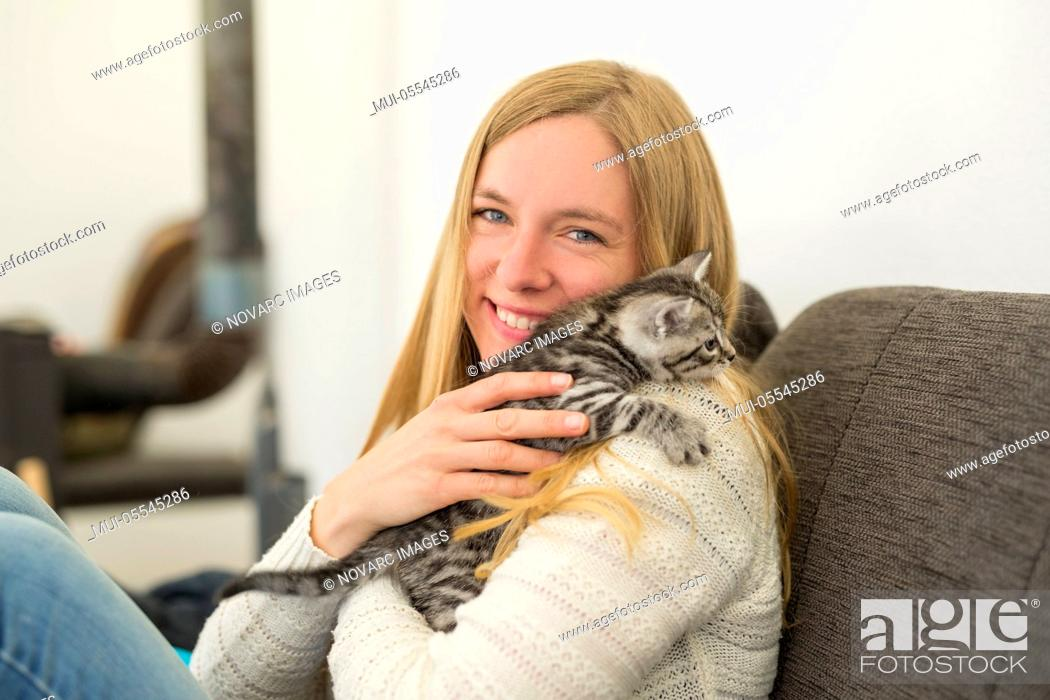 Stock Photo: Young woman with kitten.
