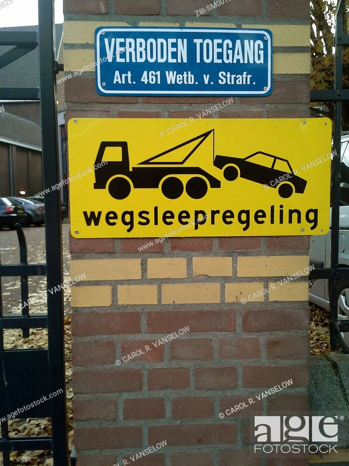 Stock Photo: Sign warning that cars that should not be parked here will be towed.