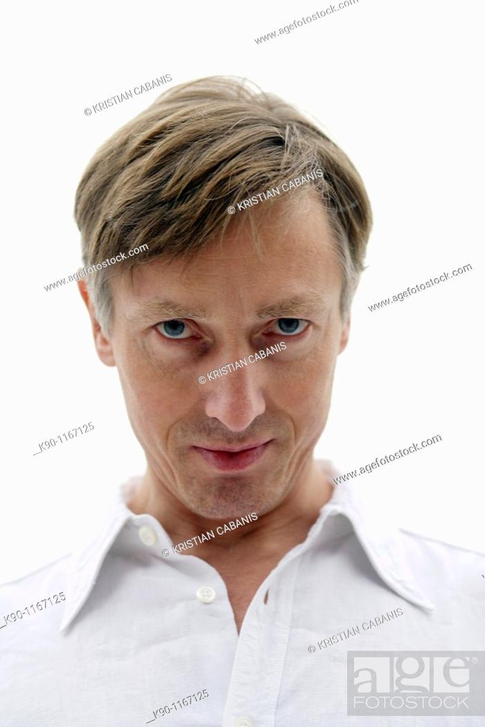 Stock Photo: Portrait of caucasian man, putting his heas down, looking at the camera.