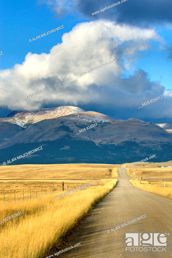 Stock Photo: Road on the Montana plains near the Rocky Mountain Front Ranges of Glacier National Park USA.