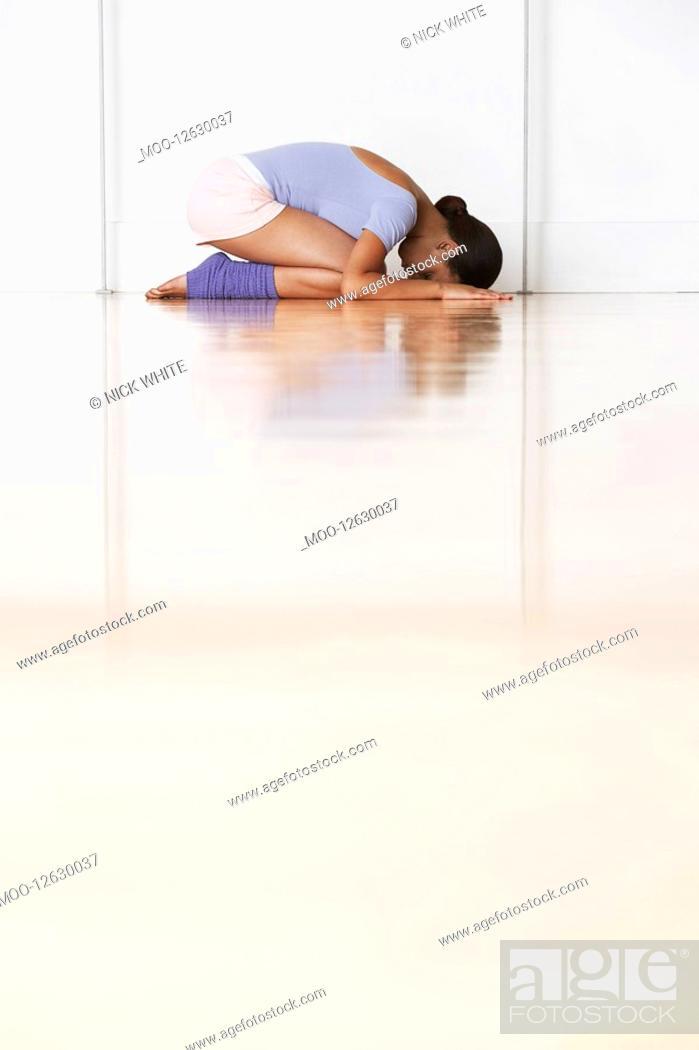 Stock Photo: Dancer crouching in prayer position.
