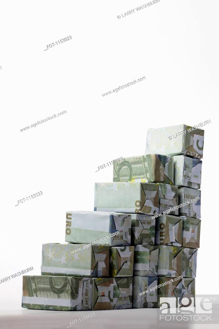 Stock Photo: Five Euro banknotes folded into rectangular boxes and arranged into a staircase.