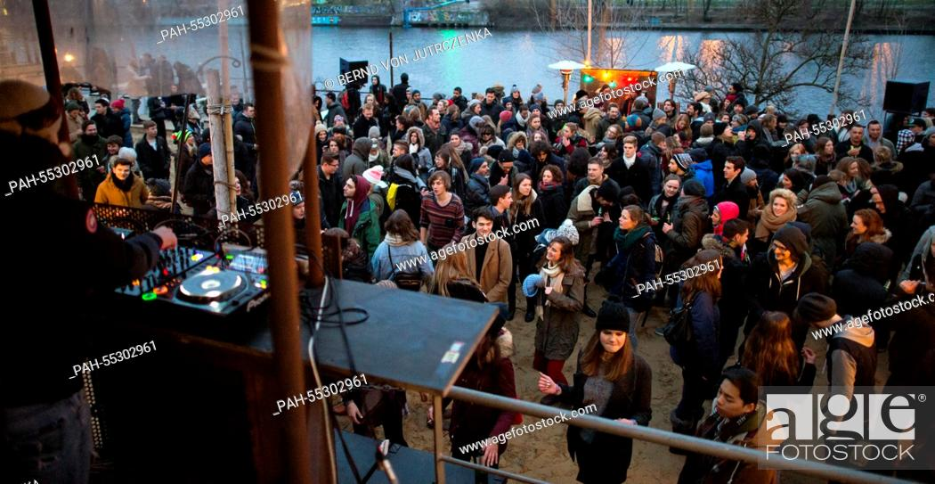 Numerous people dance in near-freezing temperatures to