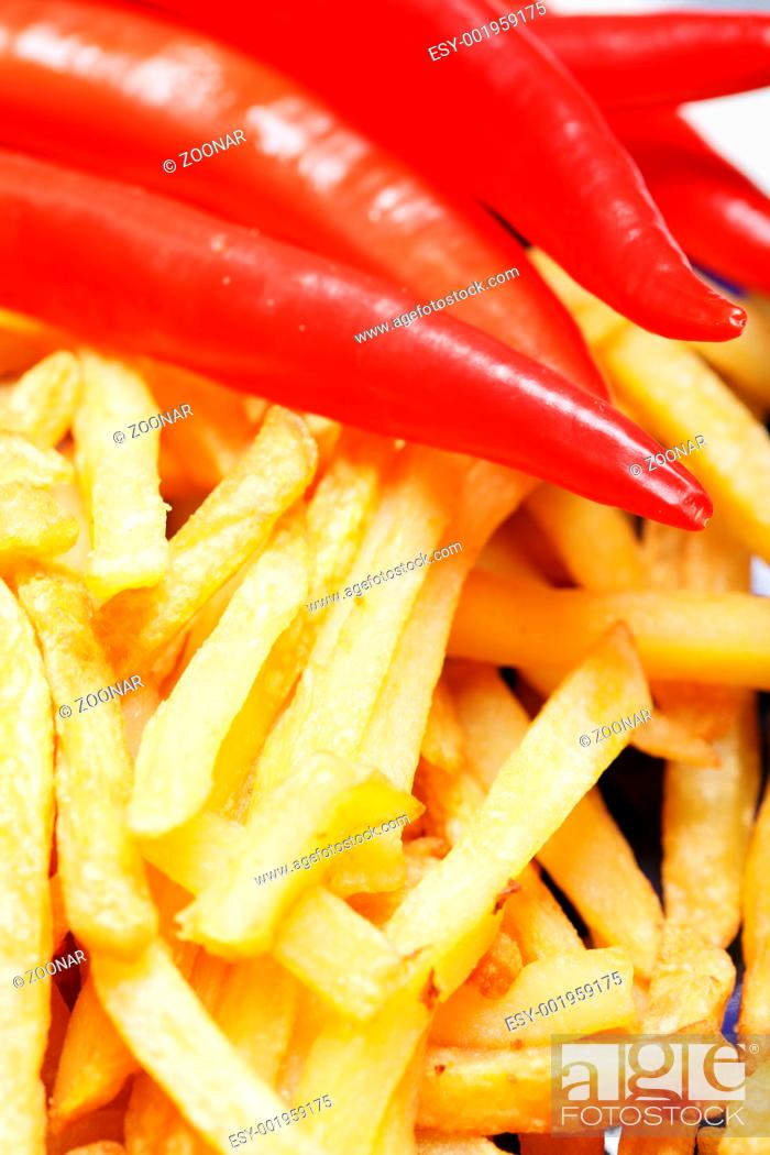 Stock Photo: French fries potatoes and chili.