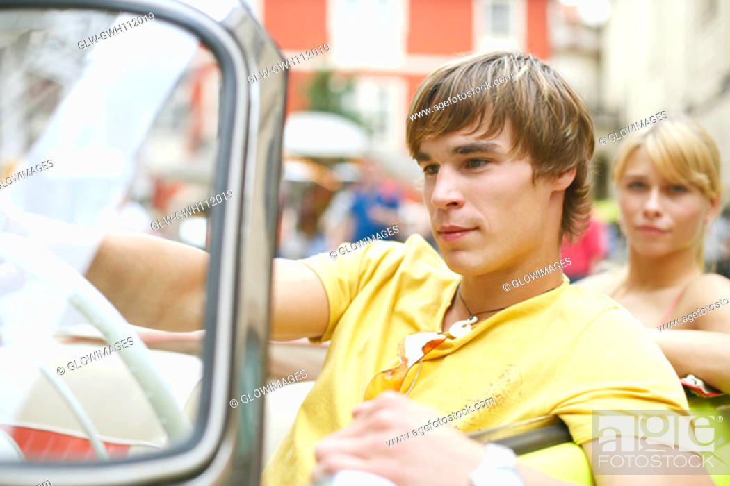 Stock Photo: Close-up of a young man sitting in a car.