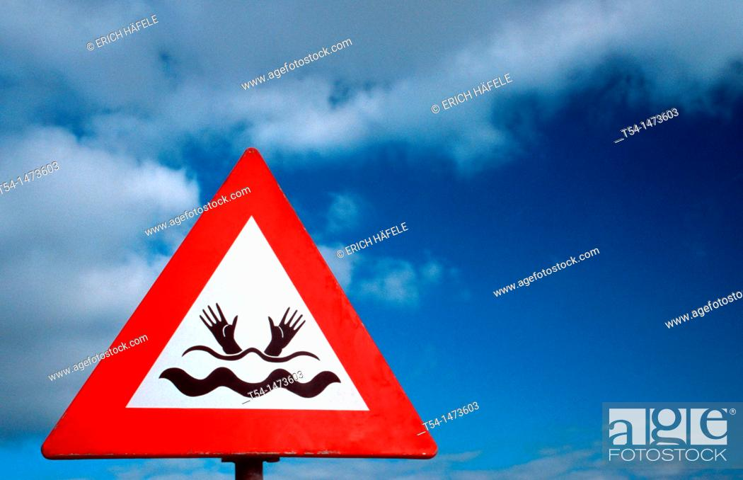 Stock Photo: Caution country under water - Warning sign.