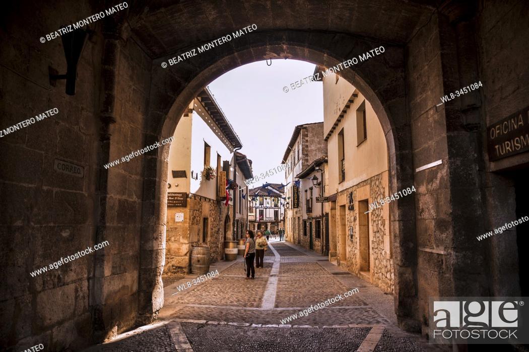 Stock Photo: Entrance to the village of Covarrubias through the arch in Burgos, Spain.