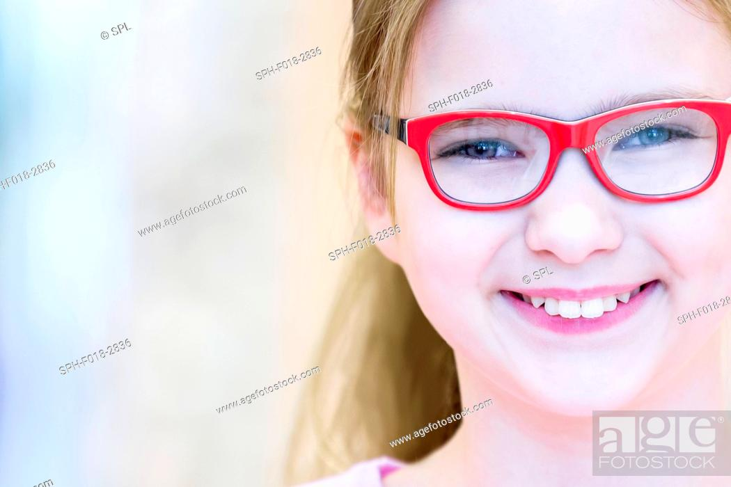 Stock Photo: Portrait of girl trying glasses in optometrist's shop.