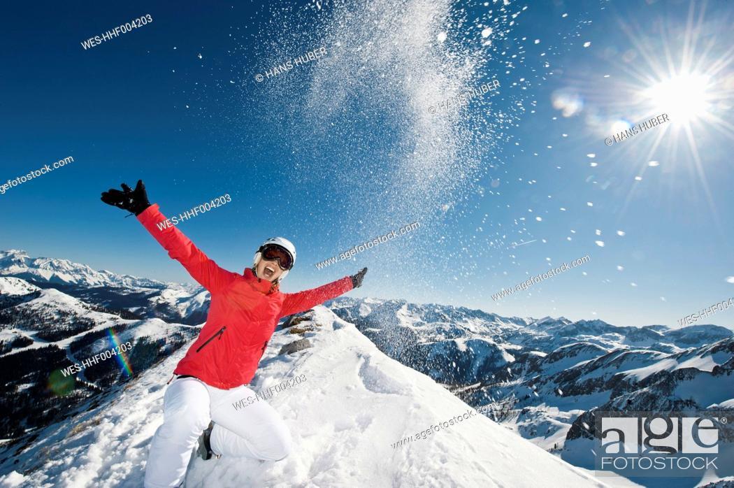 Stock Photo: Austria, Salzburg, Young woman on top of mountain.