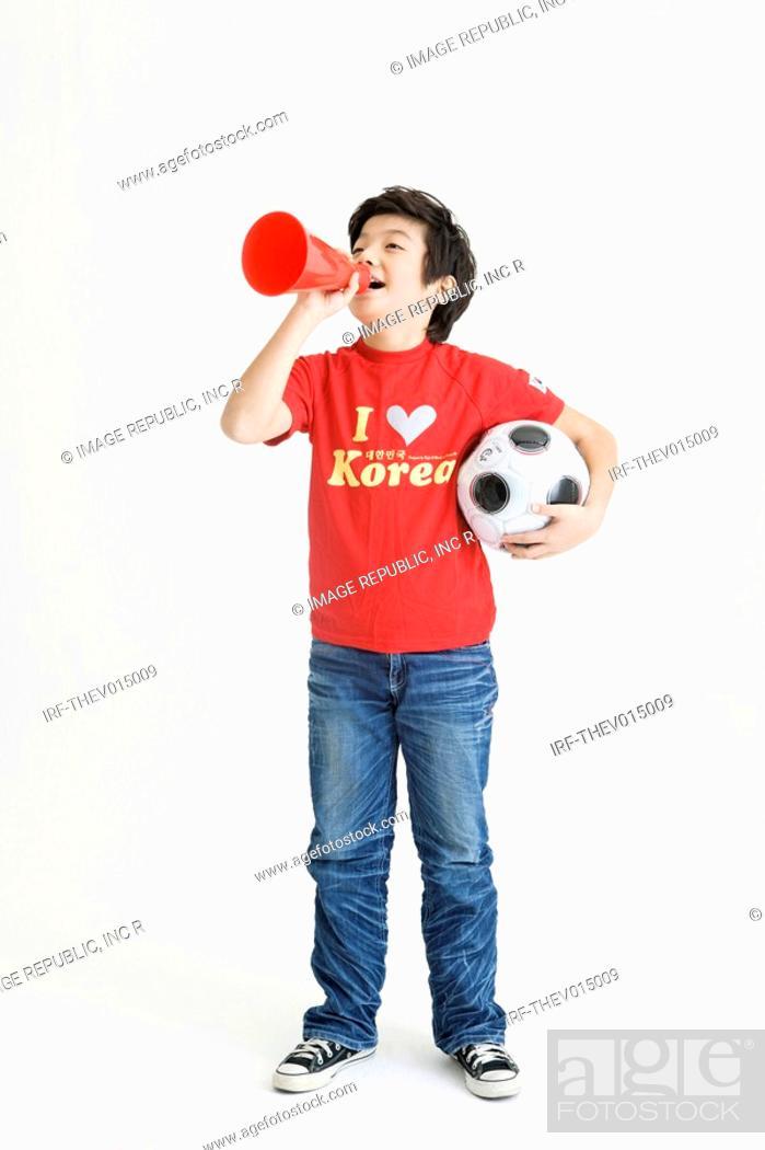 Stock Photo: boy holing soccer ball.