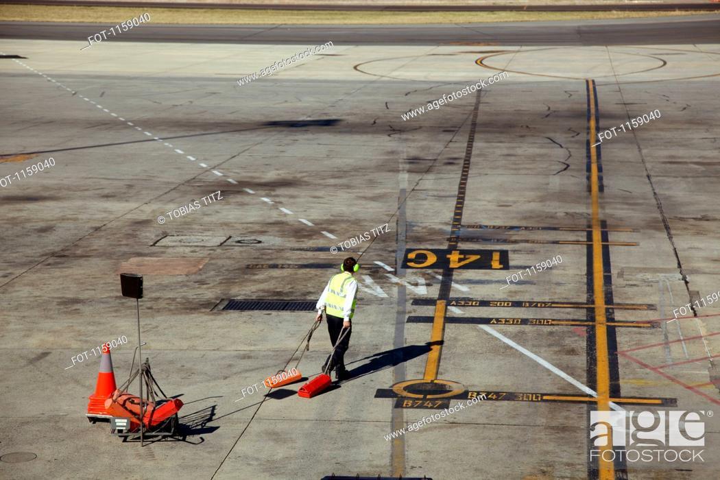 Stock Photo: Ground crew preparing for jet landing.