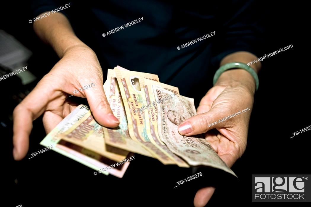 Stock Photo: Cashier counts money store Hoi An Vietnam.