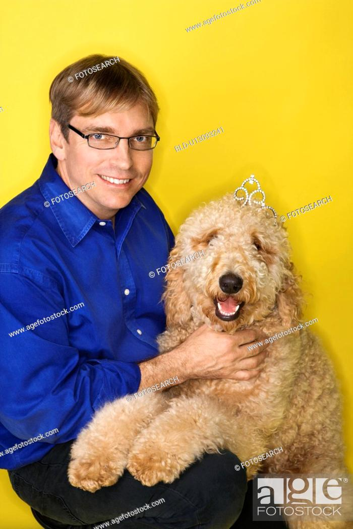 Stock Photo: Man with Goldendoodle dog.