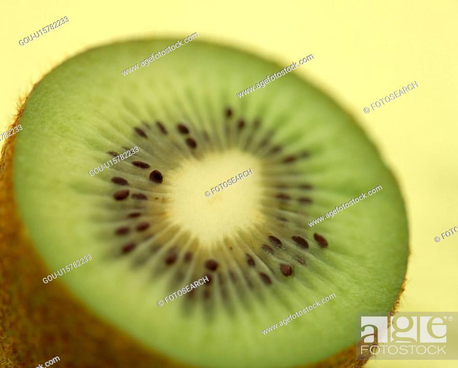 Stock Photo: The Round Slice Of A Kiwi.