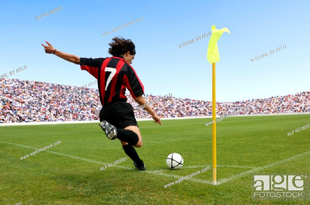 Stock Photo: Soccer player taking corner kick.