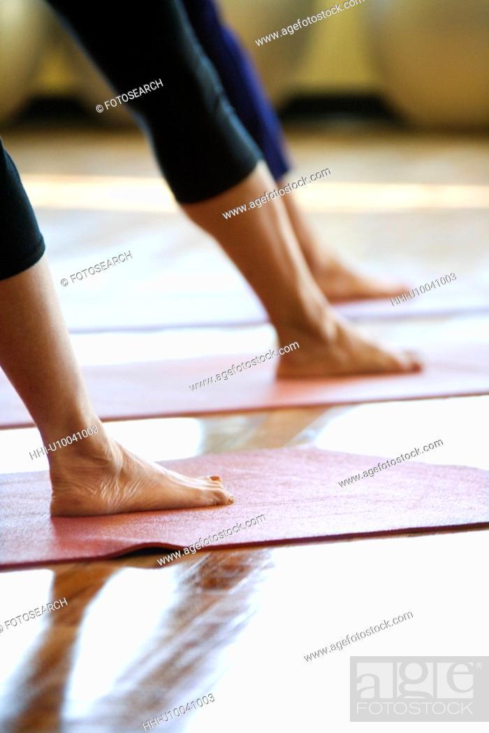 Stock Photo: Caucasian prime adult females in yoga class.