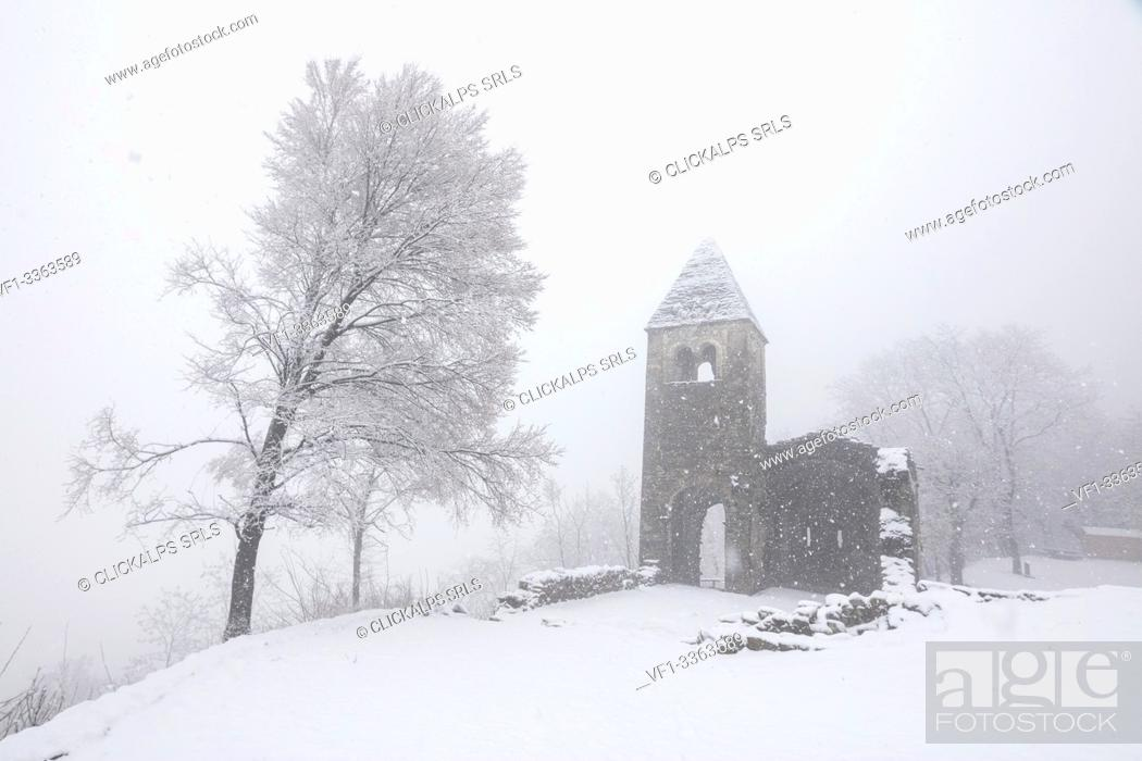 Stock Photo: Abbey of San Pietro in Vallate during a snowfall, Piagno, Sondrio province, Valtellina, Lombardy, Italy.