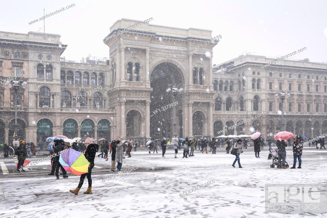 Stock Photo: The gallery of Vittorio Emanuele II and Piazza Duomo in winter during snowfall, Milan, Lombardy, Italy, Europe.