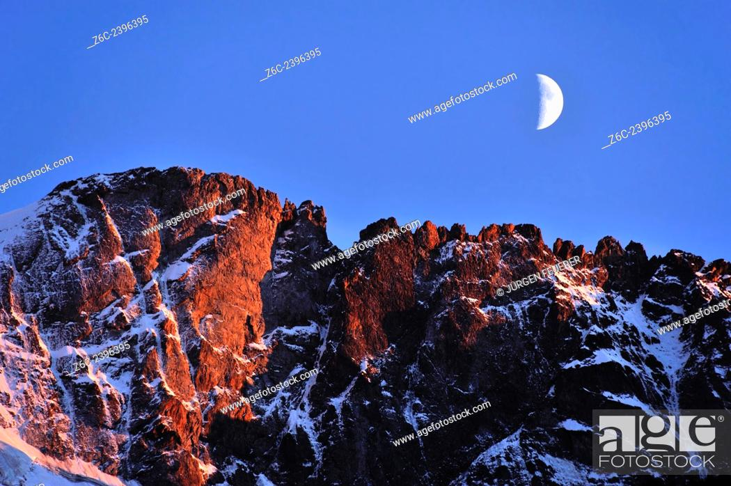 Stock Photo: Alpenglow and moon, Hautes-Alpes, French Alps, France.