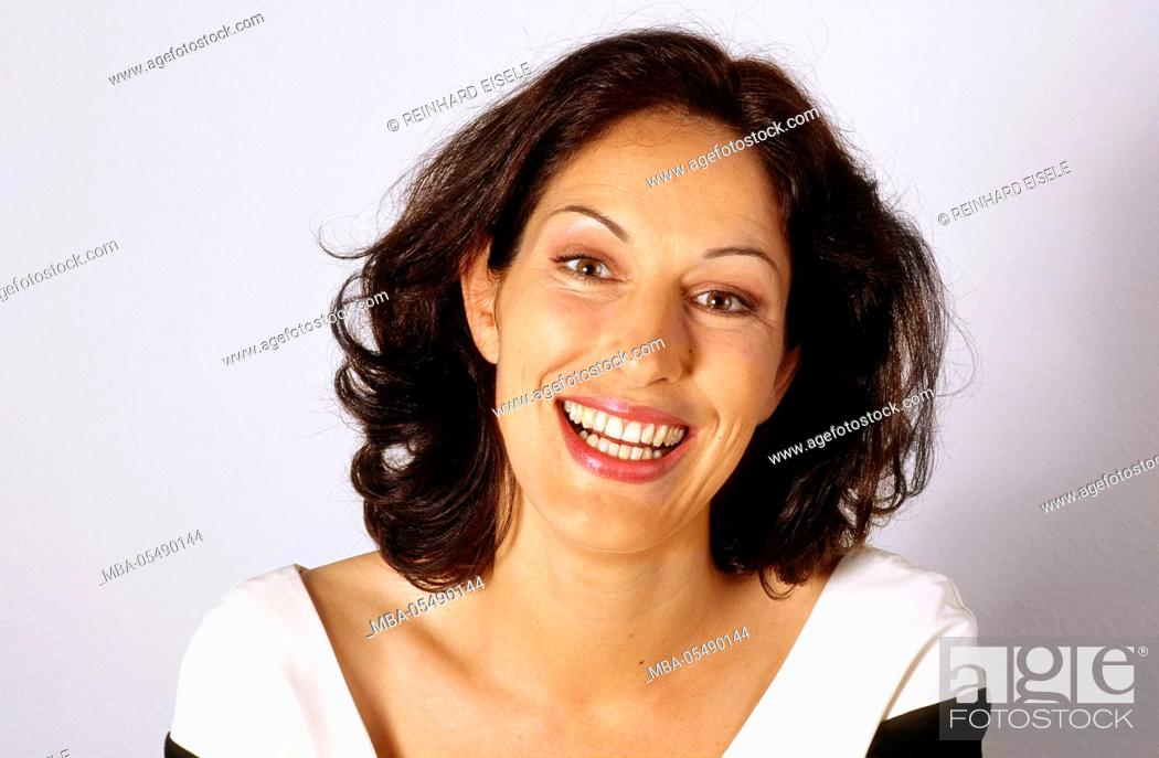 Stock Photo: Laughing dark-haired woman.