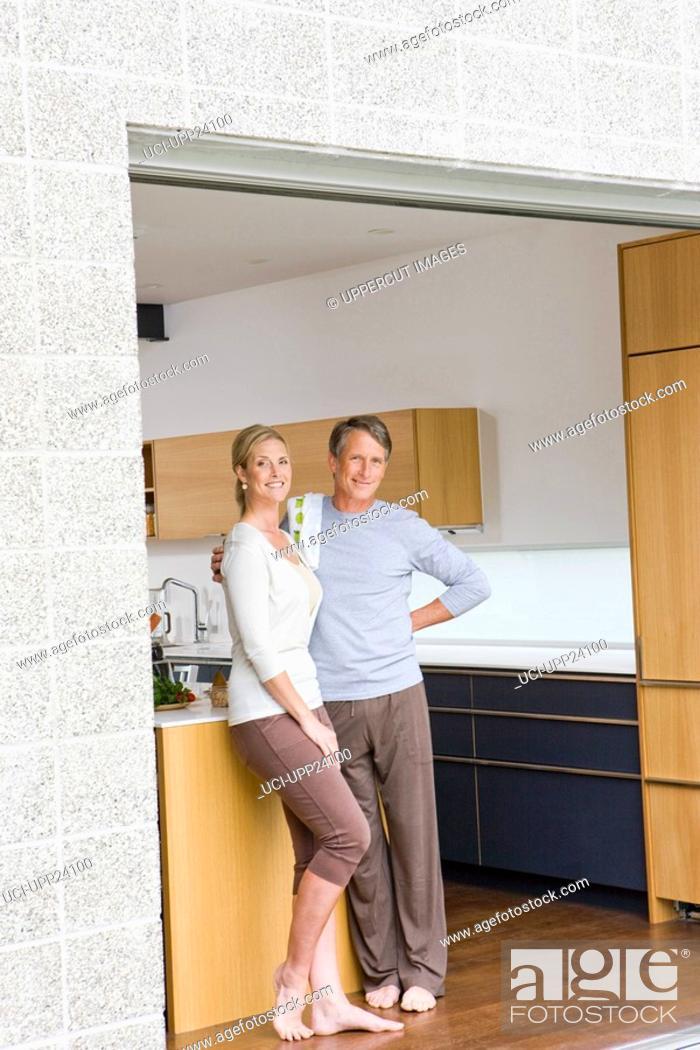 Stock Photo: Portrait of couple standing in open patio doorway.
