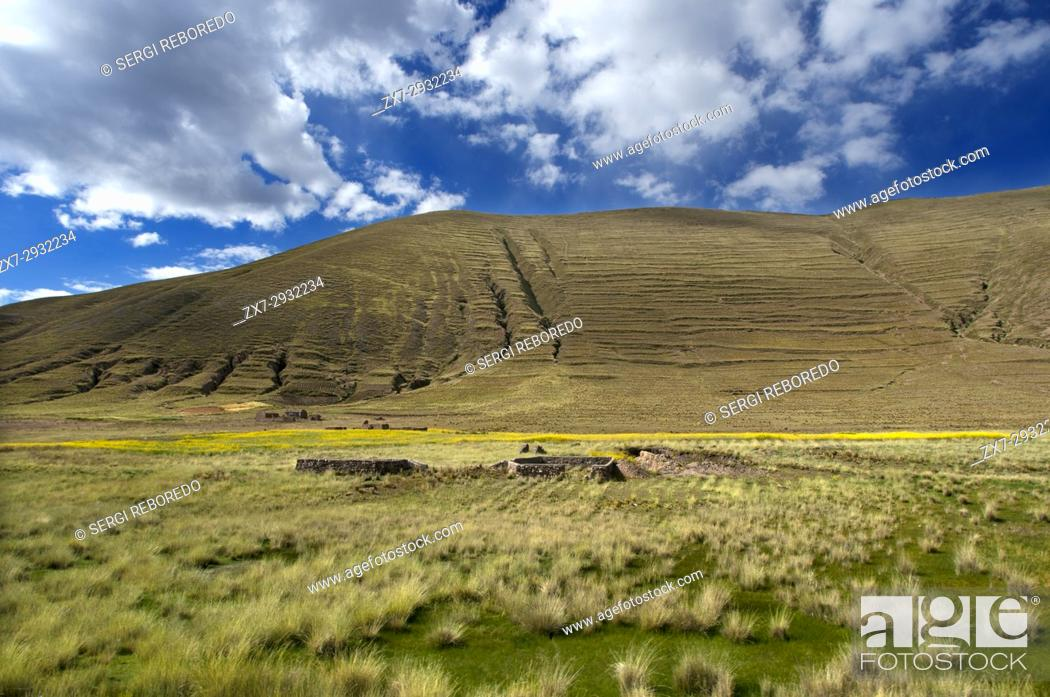 Stock Photo: Peruvian altiplano landscape seen from inside the Andean Explorer train Orient Express which runs between Cuzco and Puno.