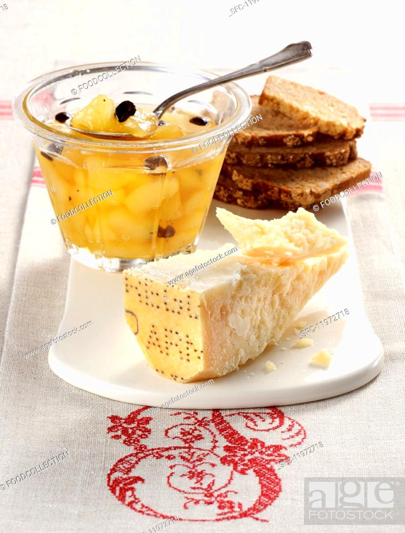 Stock Photo: Pear compote with chocolate served with Parmesan cheese and bread.