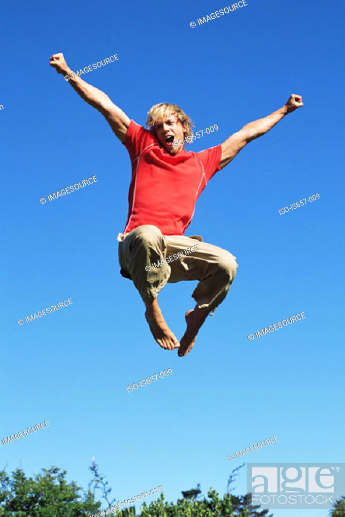 Stock Photo: Young man jumping.
