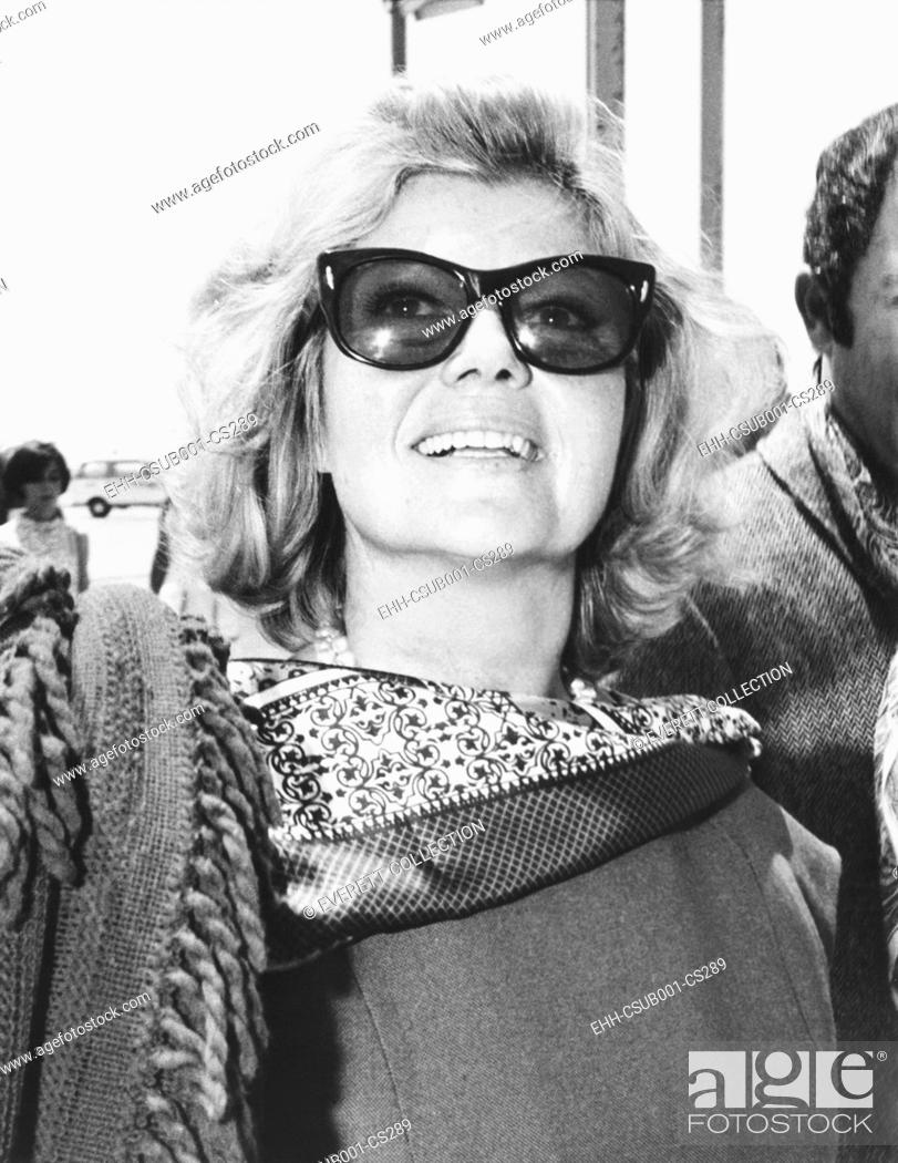 Stock Photo: Rita Hayworth arrives at Rome's Fiumicino Airport in July 17, 1968. She would be filming THE BASTARDS, (I BASTARDI). (CSU-2015-7-292).