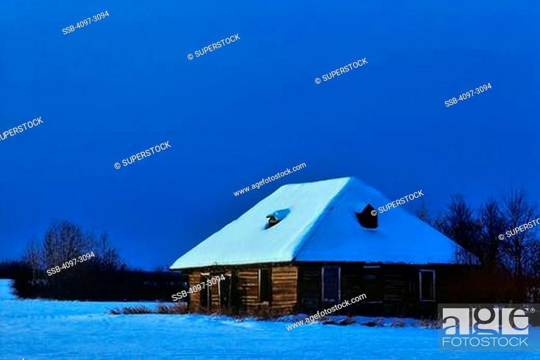 Stock Photo: Snow covered farmhouse at night, Alberta, Canada.