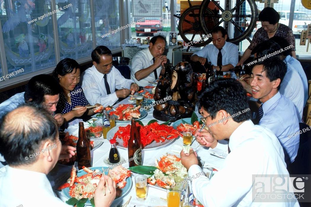 Stock Photo: Business people eating fresh crab dinner and drinking beer at restaurant on Hokkaido Island in Japan.