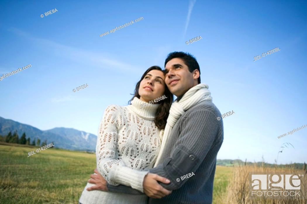 Stock Photo: casually dressed couple standing in autumn landscape.