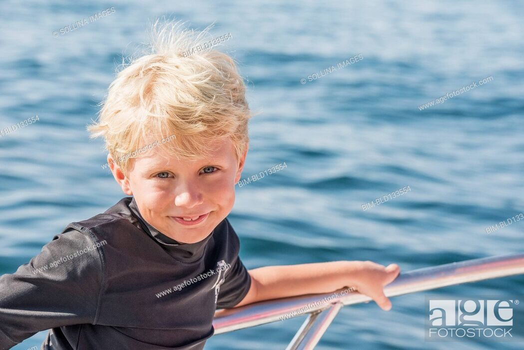 Stock Photo: Caucasian boy smiling on boat.