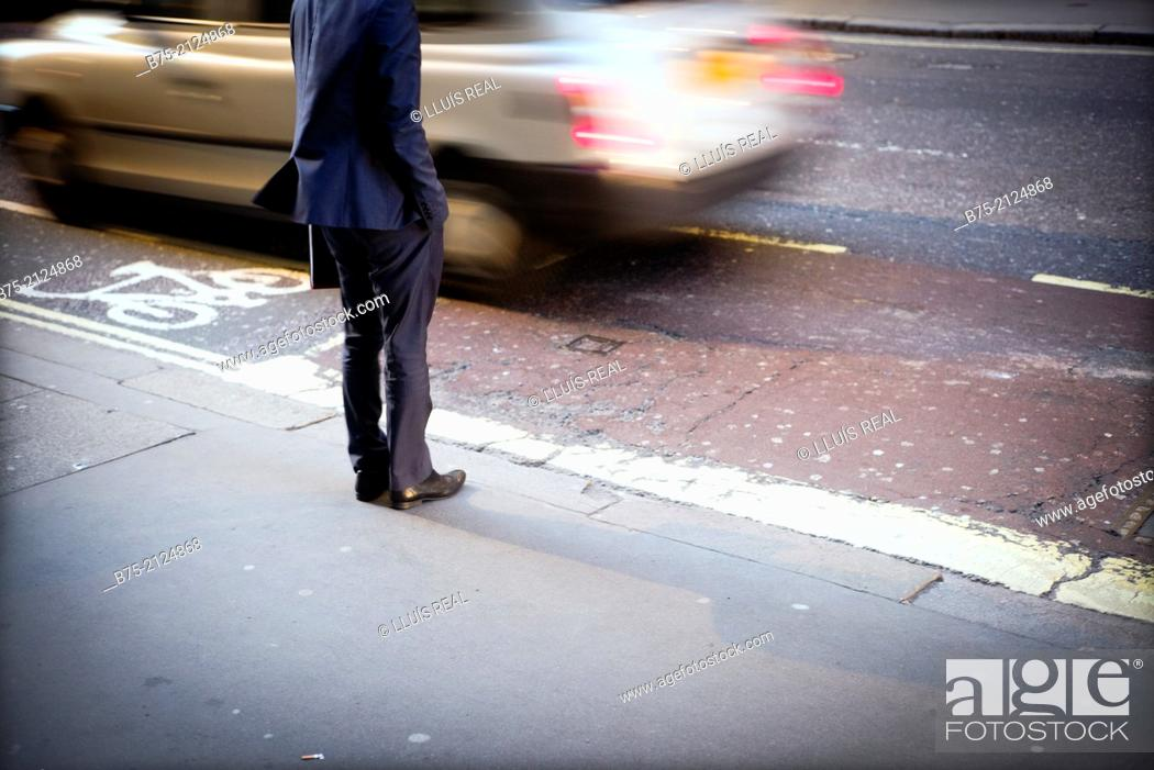 Stock Photo: one executive unrecognizable trying to cross the street in London, England, UK, Europe.