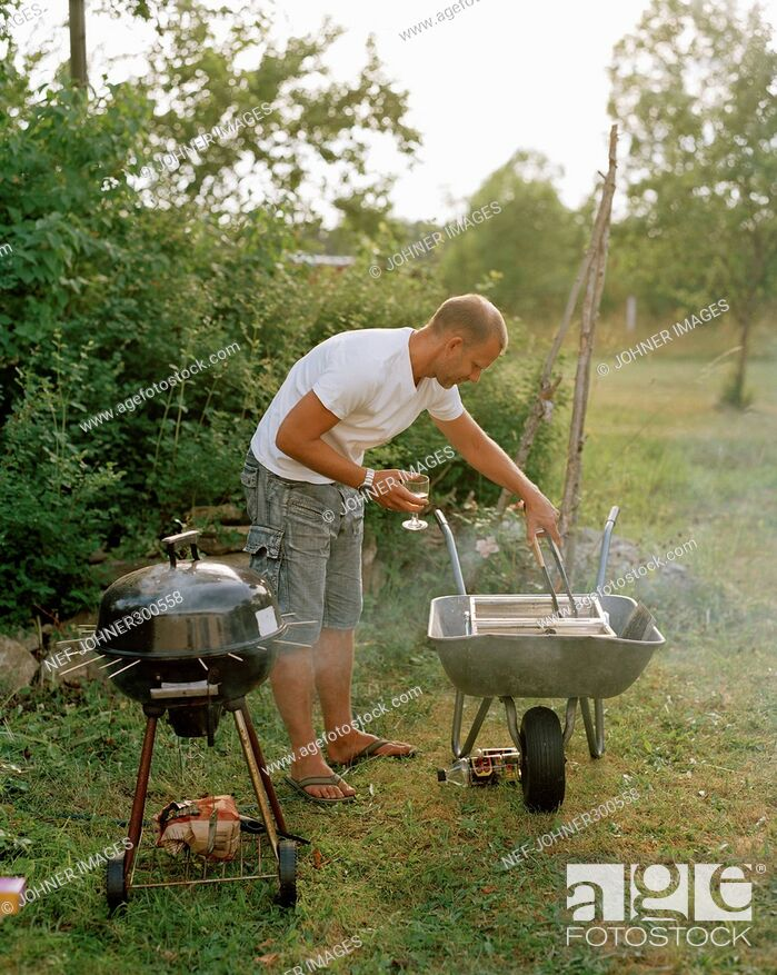 Stock Photo: A man with an outdoor grill.