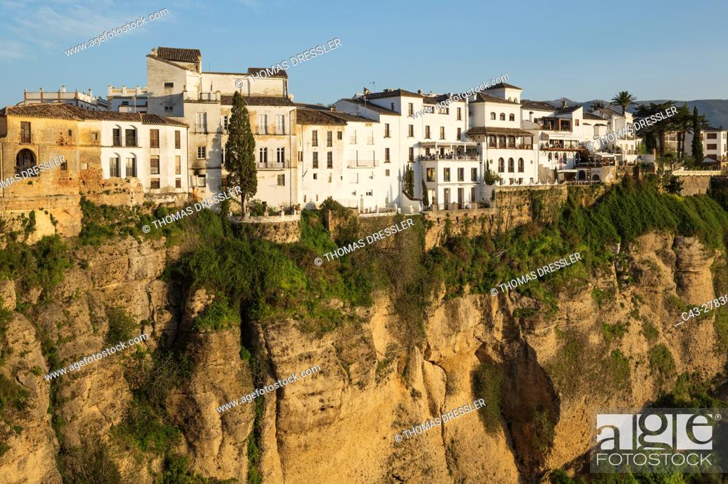 Stock Photo: The White Town of Ronda high above the river gorge El Tajo (though the river itself is the Guadalevin). Malaga province, Andalusia, Spain.