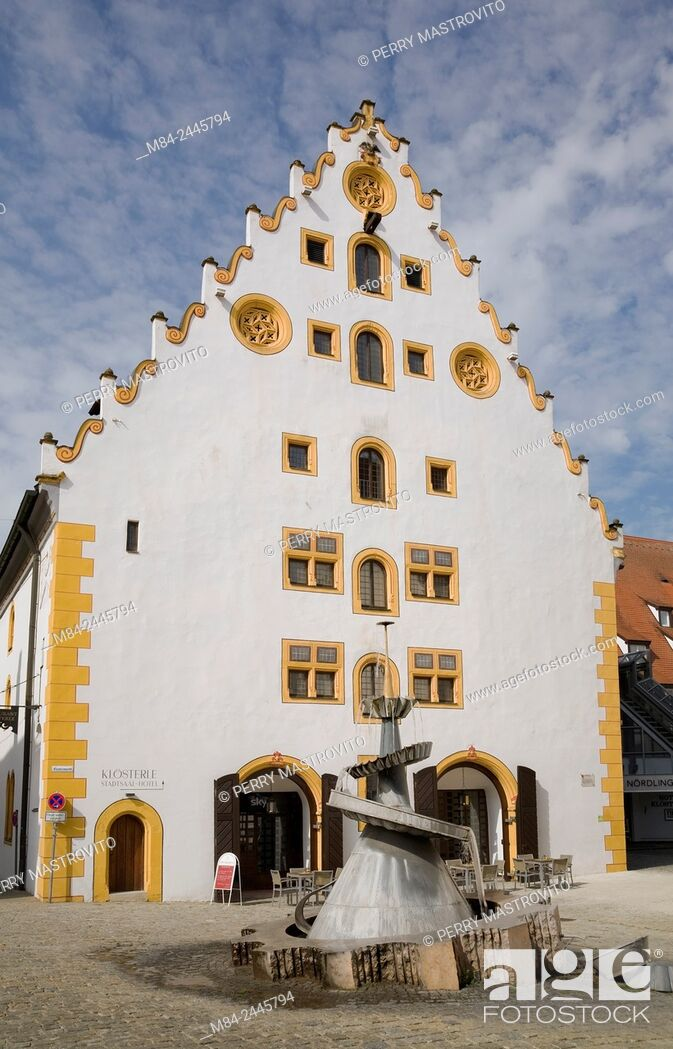 Stock Photo: White and yellow facade of the Stadtsall hotel building in the medieval town of Nordlingen, Bavaria, Germany.