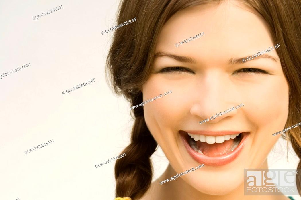 Stock Photo: Close-up of a young woman laughing.